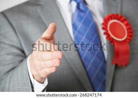 Close Up Of Politician Reaching Out To Shake Hands - stock photo