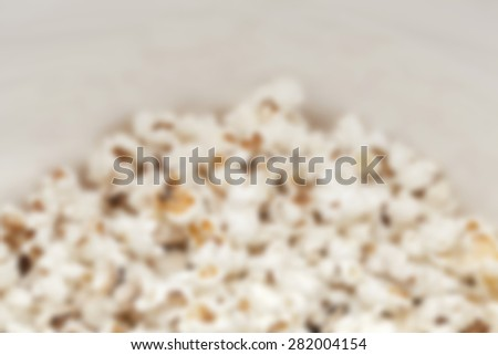 Close up of pop corns in a bowl. Post processed with blur filter.  - stock photo