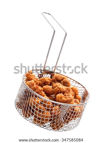 close up of popcorn chicken basket isolated - stock photo