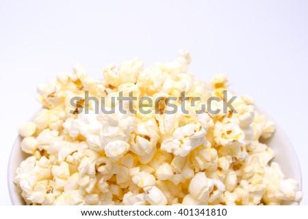 Close up of popcorn on white background - stock photo