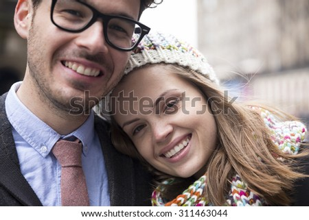 Close-up of portrait of a young romantic couple.