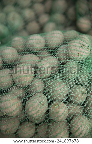 Close up of Potatoes in a net full frame - stock photo