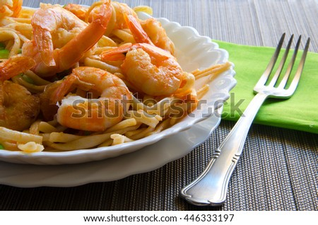 Close up of prawn pasta on grey background