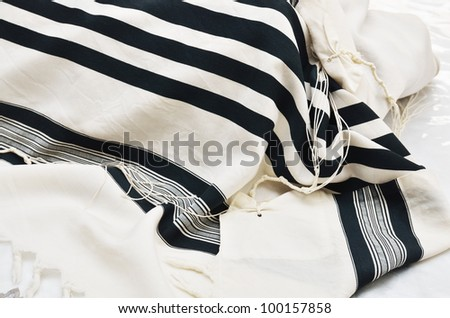 close up of Prayer Shawl - Tallit, jewish religious symbol - stock photo