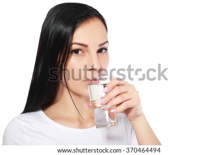 Close-up of pretty girl drinking water from glass - stock photo