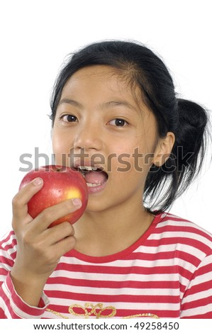 Close-up of pretty girl eating an apple