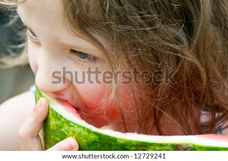 close-up of pretty girl eating watermelon