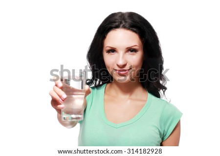 Close-up of pretty girl going to drink water from glass - stock photo