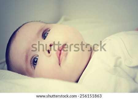 Close up of pretty infant face looking happy