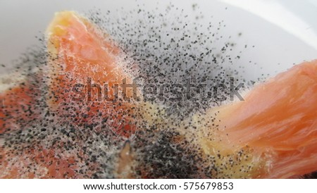 close up of pretty pink grapefruit pieces in a white bowl partially