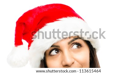Close up of pretty woman wearing christmas hat looking up isolated on white background