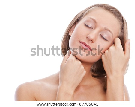 Close-up of pretty young woman touching her face