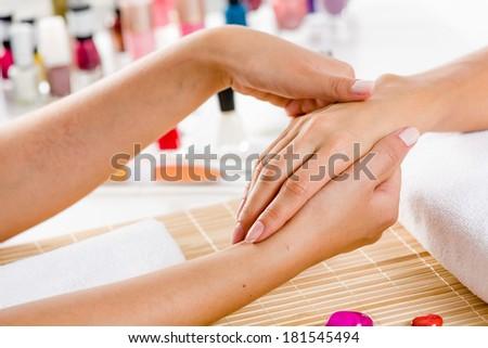 Close up of process of hand massage at beauty salon - stock photo