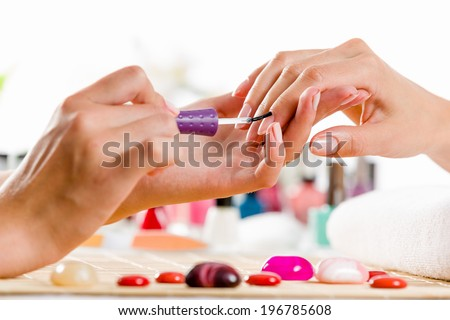 Close up of process of manicure at beauty salon - stock photo