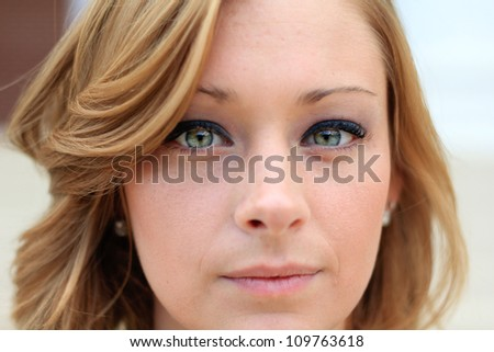 Close Up of Professional and Attractive Business Woman Looking Seriously at the Camera - stock photo
