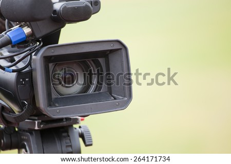 close up of professional digital video camera - stock photo