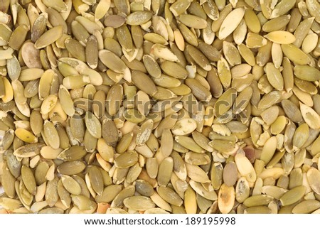 Close up of pumpkin seeds. Whole background. - stock photo