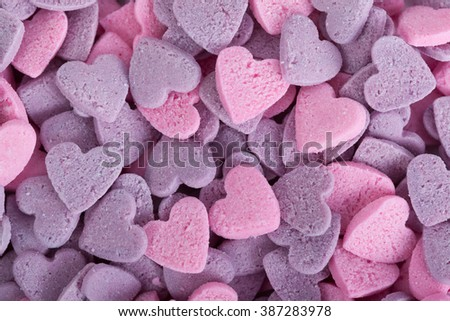 Close up of purple ad pink candy hearts
