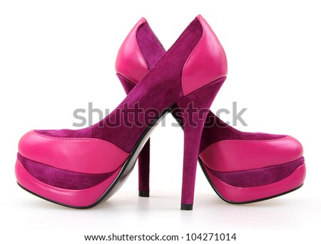 Close up of purple high heeled women shoes isolated on white with path