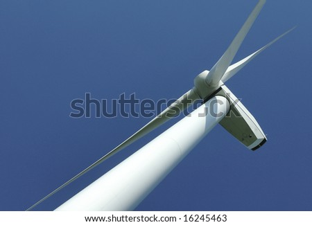 close up of pylon's windturbine on blue sky in France - stock photo