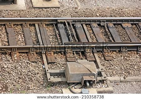 Close-up of railway switch. - stock photo
