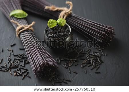 Close-up of raw black rice noodles, horizontal shot - stock photo