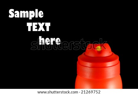 Close-up of red aerosol can nozzle isolated on black - stock photo