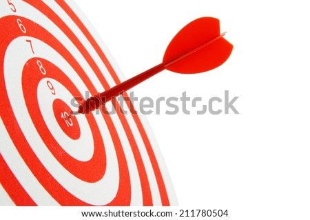 Close up of red and white shooting target and arrow isolated - stock photo