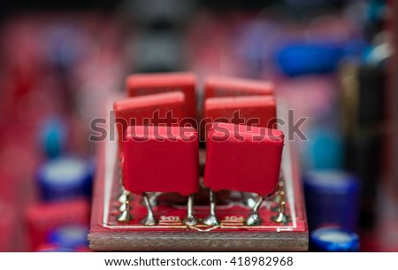close-up of red capacitors over blurred background - stock photo