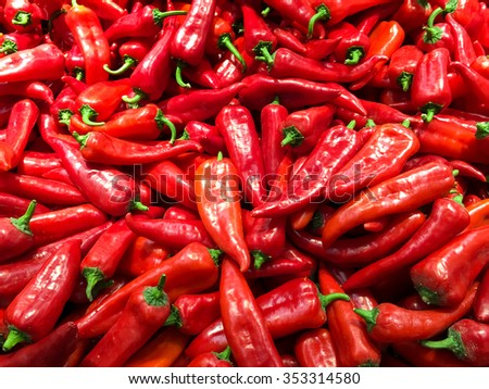 Close Up Of Red Capsicum In Vegetable Market Display - stock photo