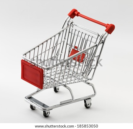 close up of red chrome shopping cart on white background - stock photo