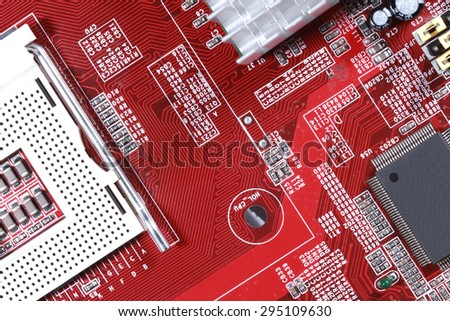 Close-up of red electronic motherboard circuit board with processor - stock photo
