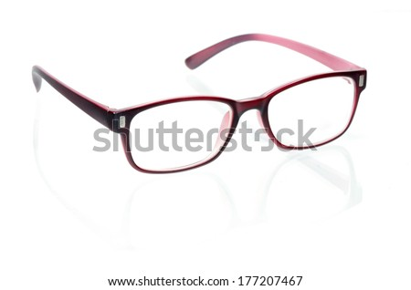 Close-up of red glasses on white background.