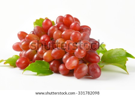 close up of red grapes on white background