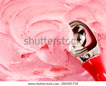 Close Up of Red Handled Scoop Serving Pink Strawberry Ice Cream - stock photo