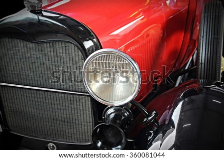 Close up of red old antique car - stock photo