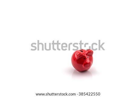 Close up of red piggy bank isolated on white background with golden coin - stock photo