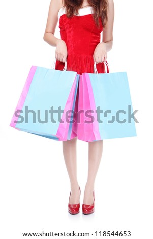 close up of red shopping woman leg and bag isolated on white background