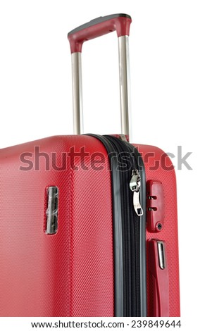 Close up of red travel luggage isolated on white background, selective focus.