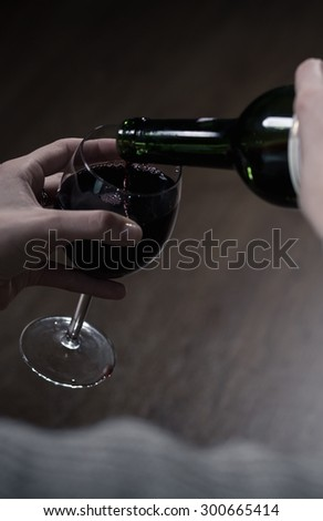 Close-up of red wine in big glass - stock photo