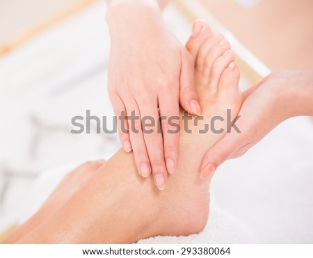 Close-up of relaxation pedicure process in spa salon. - stock photo
