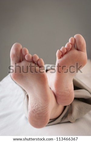 Close-up of relaxed feet-up
