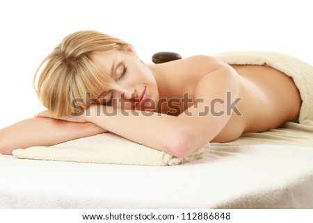 Close-up of relaxed woman in spa center isolated on white - stock photo