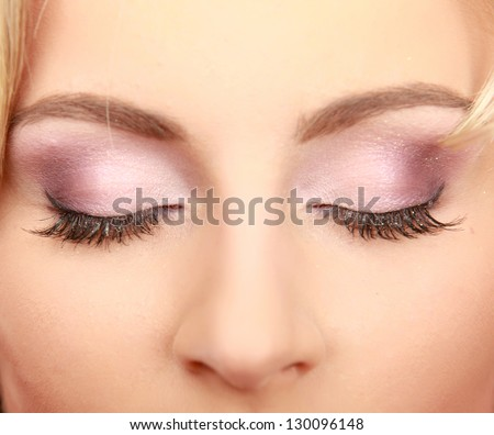 Close-up of relaxed young woman with closed eyes. - stock photo
