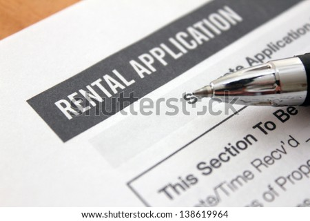 close up of rental application with pen - stock photo