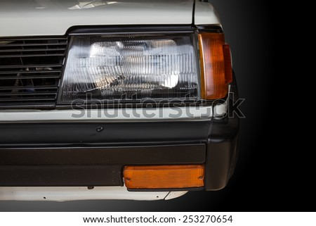 Close up of retro car headlight - stock photo
