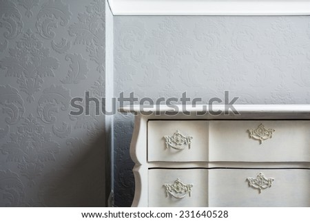 Close-up of retro style white sideboard in the corner - stock photo