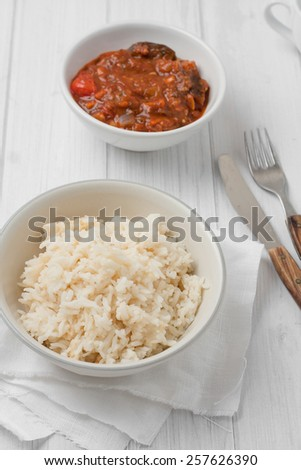 close up of rice cooked in chicken stock in a white bowl - stock photo
