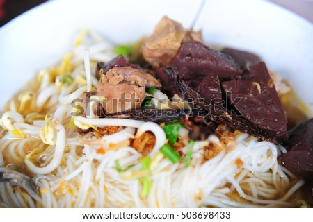 Close up of Rice noodles with spicy pork sauce, Thai traditional Food