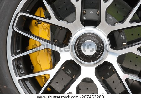 Close up of rims form a sportscar - stock photo